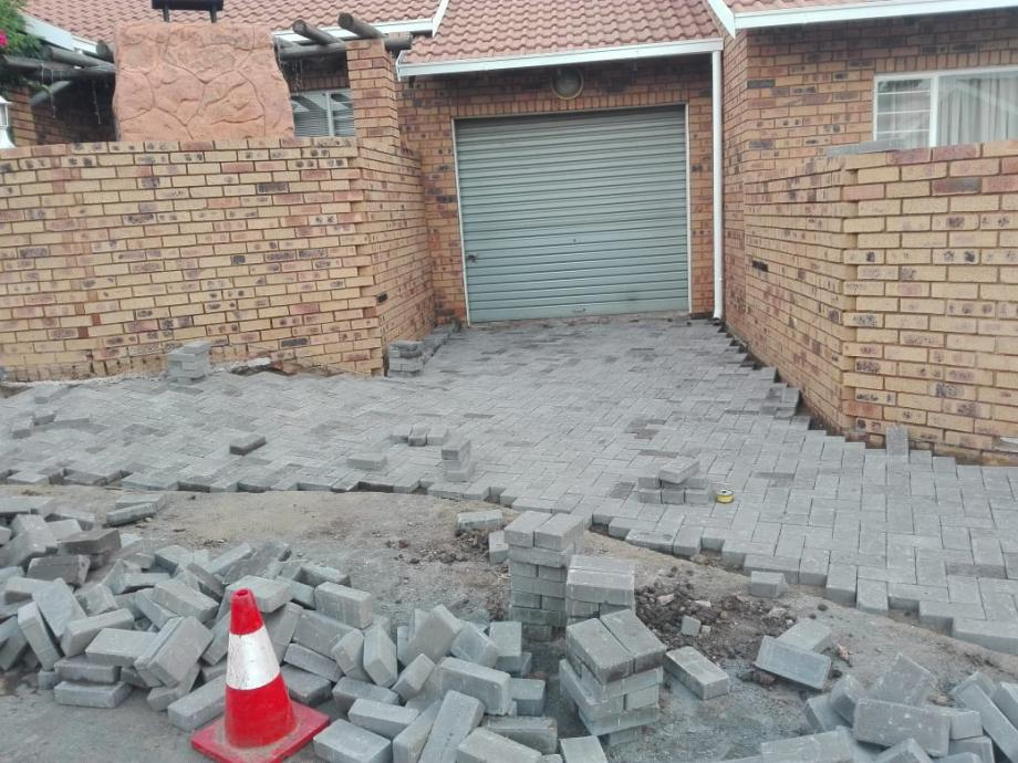 tar surfacing and brick paving